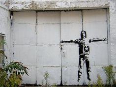 Bansky,  Jesus on a house, Brick Lane, London. September 2005.