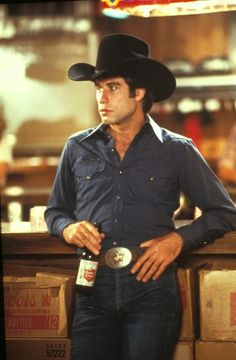 """Urban Cowboy is a 1980 American western romantic drama film about the love-hate relationship between Buford Uan """"Bud"""" Davis (John Travolta) and Sissy (Debra Winger). Description from imgarcade.com. I searched for this on bing.com/images"""