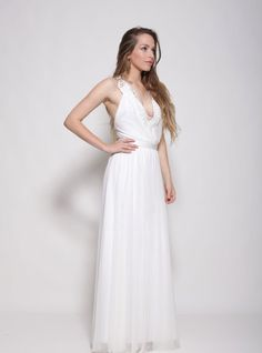 This classic boho wedding dress with embroidery collar and open back is perfect for a beach wedding or a garden wedding with embroidery pattern in cleavage . The romantic and graceful silhouette emphasize feminine shape .   ✦ Standard length of the dress is 143 cm from tip of shoulder to floor- if you want the dress longer just note ✦ Two layers of fabric - upper layer Luxe stretch mesh, lining stretch rayon   ✦ It takes me about 10 days to make a wedding dress according ones measurements…