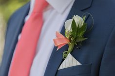 Quinton & Grace- July 3rd 2015. Navy blue suit with silk coral tie and buttonhole. www.rachelnielsenphotography.com