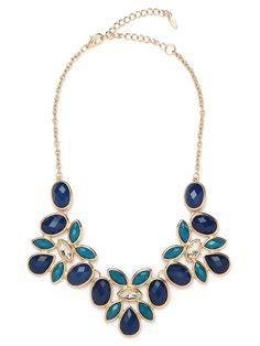 This striking statement necklace works a pretty feminine vibe, with its exquisite floral pattern of gems. It's glamorous and romantic all at once.