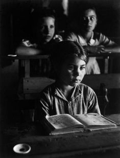 """Boy reading with other students. Extremadura, Province of Caceres, Deleitosa, Spain, 1951. From """"Spanish Village"""" photo-essay. By W. Eugene Smith (1918-1978)."""