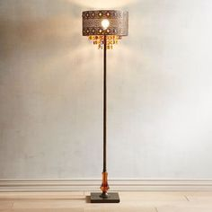 Lighting is an artful endeavor, especially in the case of our bejeweled floor lamp. Influenced by modern bohemian styling, our gleaming, metallic lamp features a punched floral pattern and warm multicolor crystal beads and drops. Rustic Floor Lamps, Rustic Lamps, Farmhouse Lamps, Modern Farmhouse, Silver Floor Lamp, Best Desk Lamp, Traditional Floor Lamps, Large Lamps, Contemporary Floor Lamps