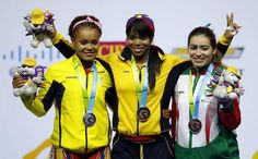 July 14 - Weightlifting - Women's - 69 kg.   Leidy Solis Arboleda, centre, of Colombia - Gold. Neisi Dajomes Barrera (L), of Ecuador - Silver.  Aremi Fuentes (R), of México - Bronze.