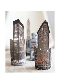 DIY glowing skyline - cut out building printouts and wrap around candles