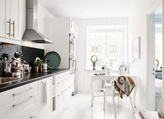 One sided kitchen design makes a galley style room feel bigger.
