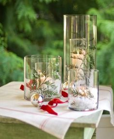 Create a white Christmas using inexpensive glass cylinders from a crafts store. More Christmas centerpieces: http://www.midwestliving.com/homes/seasonal-decorating/easy-christmas-centerpiece-ideas/?page=25,0