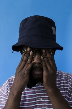 -based producer Knxwledge, the shadowy streets of his current hometown are swapped out for vibrant yellow and blue backdrops. Travis Scott, Bucket Hat Outfit, Men Photography, Carhartt Wip, Street Photo, Photo Reference, Looks Vintage, Photo Poses, Effigy