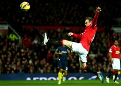 Wayne Rooney launches himself towards the ball during @manutd's game against Southampton in January 2015.