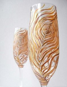 Albino Peacock Wedding Toasting Flutes-Set of Two. I am NOT a fan of painted stemware, but these are AMAZING!