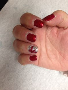 Red sparkle with silver glitter accent nail and present design Oasis Salon and Spa Mill Hall Pa (570)726-6565