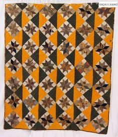 Lemoyne Star quilt, circa 1850-75, from Florida documentatioin project. Cheddar, black and brown fabrics with a spot of red.