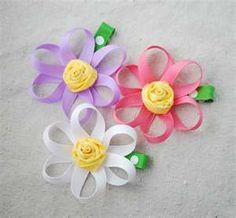 Flower hair bow with rosette center