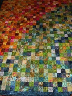 Here is a simple quilt done in Stonemountain's batik fabrics which she loves, loves, loves! Her daughter went to college back east and she made a similar quilt for her to take with her to cheer up her dorm room on those long winter nights. It worked wonders and she received tons of compliments about her room decor which really was limited pretty much to the quilt!