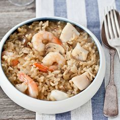 Shrimp and Bay-Scallop Risotto with Mushrooms | Fresh and dried mushrooms give this risotto a double dose of earthy flavor. You can use twice the shrimp and no scallops, or the reverse. If you prefer sea scallops, quarter them.