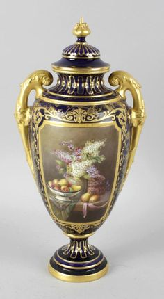 A Royal Worcester bone china twin handled vase and cover, the cobalt blue glazed ground hand painted with a panel dep. on Mar 2018