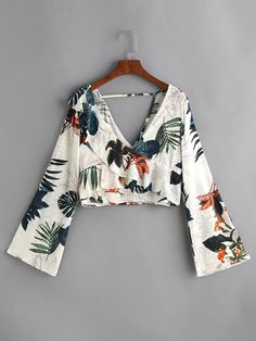 Shop Floral Print Plunging V Neckline Crop Top online. SheIn offers Floral Print Plunging V Neckline Crop Top & more to fit your fashionable needs.