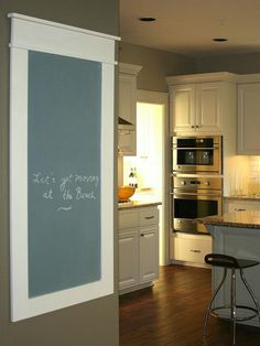 Build a custom-framed chalkboard to hang in your kitchen, creating a central location for everyone to leave messages, write to-dos and keep up with each others' schedules.