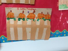 5 little pumpkins sitting on a gate by preschool ages 3-4 (used children's knuckles for the pumpkin, used their thumb to make the leaves..children cut the pieces to make the gate )