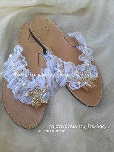 a pair of wedding sandals with white lace, swarovski beads , pearls and strass starfish. Availiable from 36/eu size until 42/eu size. For more informations sent me mail at elenasandals@gmail.com