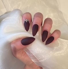 Burgundy matte stiletto nails with rhinestone and gold bead details by nailartbygeorgia on Etsy https://www.etsy.com/listing/251812184/burgundy-matte-stiletto-nails-with