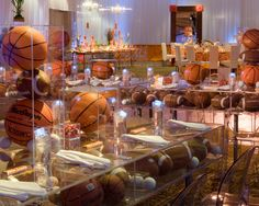 David Tutera - Sporty...Absolutely love the lucite tables with all of the different sports balls!