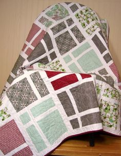 Blitzen Lap Quilt Winter Snowman via Etsy.   In Christmas fabrics these squares would look like gifts.