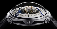 Vianney Halter Deep Space Tourbillon / Price: $199,800 USD. / An immense domed, spheric crystal protects the centrally placed triple axis tourbillon and also gives the wearer, and everyone around him or her, a magnificent view on that tourbillon. Around the almost space-station-like construction with the triple-axis tourbillon, rotate the hour and minute hands.
