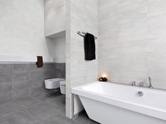 GRIGIO FUMO The Portland Series is a matte tile with a slight wave to the surface. There are 3 colours available which include: Portland Grigio and Portland Fumo. Bathroom Floor Tiles, Bathroom Renos, Tile Floor, Portland, Minimalist Bathroom, Modern Bathroom, Master Bedroom Bathroom, Tile Showroom, Ideas Geniales