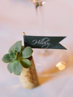 succulent wine cord name card, photo by Lavender & Twine http://ruffledblog.com/santa-barbara-courthouse-wedding #weddingideas #namecard
