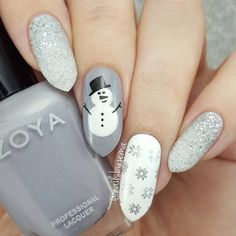 Winter nail art design,silver glitter nail art design for winter,snowman and snowflake winter nail art ideas