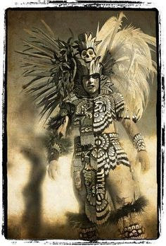 Aztec Warrior  Another possible tribal chieftain of high status individual. It must be remembered that   the costumes available to city dwellers could be more sophisticated materials and designs. Aztec/Mayan and Incan culture is only a starting point. The feathers and the glyphs and the ornate collars...check.