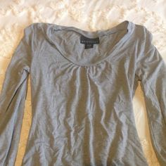 Buy One Get One FREE Solid gray long sleeve top with a nice silky cotton stretch feel to it. Never worn. Sleeves have a cinche detailing at the upper wrist. Casual and dressy! Tops
