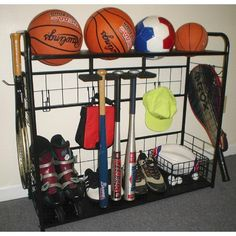 Sports equipment can cause a mess in any garage or storage area. With this Sports Equipment Organizer you will have one designated space for all your balls skates sticks bats and other gear. This standing sports rack is made of  steel with a black powder coated finish so you know it is built to last. The grid design le