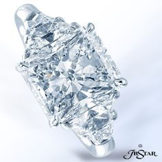 Style 2302 Platinum engagement ring is classically designed and features a stunning 4.43ct radiant diamond, highlighted by trapezoid diamonds. #engagementring