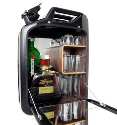 """Bar cabinet from Danish Fuel in Pitch Black- Upcycled Jerry Cans form Holds bottles of liquer and glasses. For another kind of ,,FUEL"""" Mini Bars, Jerry Can Mini Bar, Wall Mounted Bar, Walnut Shelves, Mens Gear, Gadget Gifts, Decoration, Modern Design, Gadgets"""