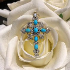 A Victorian Turquoise and Diamond Cross Pendant. In store now.