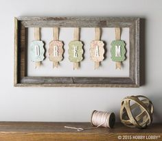 If you've got a pile of flea-market frames just waiting for a purpose in life, this project is the perfect fix. Simply sandwich ribbon between pairs of paper-covered chipboard shapes. Then top with die-cut wooden letters and suspend as shown.