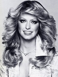 1970s inspiration was about the natural wispy Farrah Fawcett hair. Glossy glamorous lips, Natural contour, Bronzed, Very Defined eyes, sheer glow and being all tanned up!