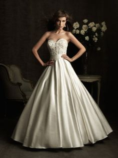 This wedding dress features gorgeous flowing skirt. Strapless sweetheart neckline and floor length is also included. The bodice is adorned with fancy applique and beads. Free made-to-measurement service for any size. Available colors seen as in Color Options.