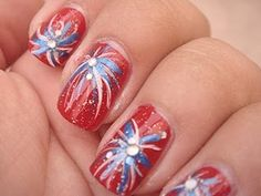 4th of July Nails. Good idea. I think I'd paint the nails red white and blue and use different colors in the fireworks. :)