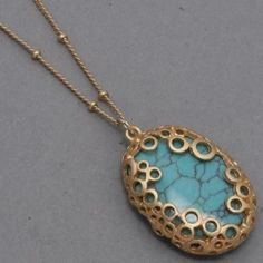 Gold Detail with Turquoise Pendant