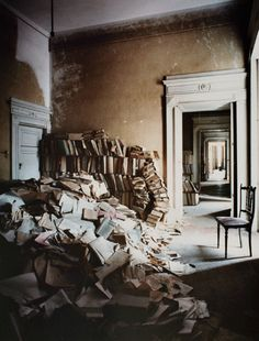 I would move in. Book by book, I would restore order. I would be sad, but not lonely, and not unhappy. - Kathleen Fitzhugh       (An abandoned library in Napoli by Barry Cawston)
