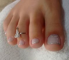 Beautiful neutral pedicure with just the right amount of bling by @luzilenemorais