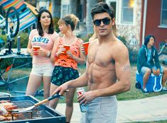 Zac Efron looks yummier than the food he's barbecuing.