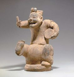 A PAINTED POTTERY FIGURE OF A DRUMMER HAN DYNASTY (206 BC-AD 220)