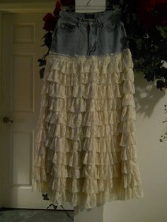Another skirt DIY that I MUST make! I have several pairs of ripped jeans that I just can't let go of....now I know what to do with them! Bohémienne ruffled lace jean skirt.
