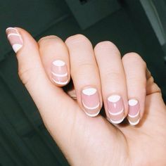 Mix up your French manicure with a half-moon design.