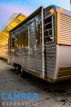 The 1966 Boles Aero with a customized concession window by CAMPER REPARADISE: vintage trailer restoration in West Valley, UT.