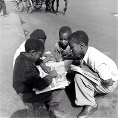 Young boys talk over the day's news Harlem 1938. (Hansel MiethThe LIFE Picture Collection/Getty Images) by life